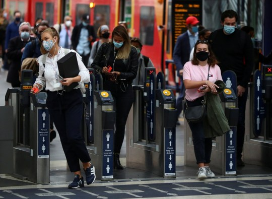 FILE PHOTO: People wearing protective face masks make their way through Waterloo station during the morning rush hour, amid the coronavirus disease (COVID-19) outbreak, in London, Britain, September 23, 2020. REUTERS/Hannah McKay/File Photo