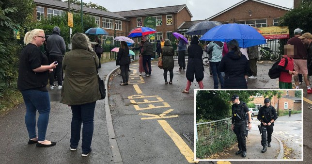 School locked down as armed police swarm area after reports of 'man with gun' Connaught Junior School, Bagshot