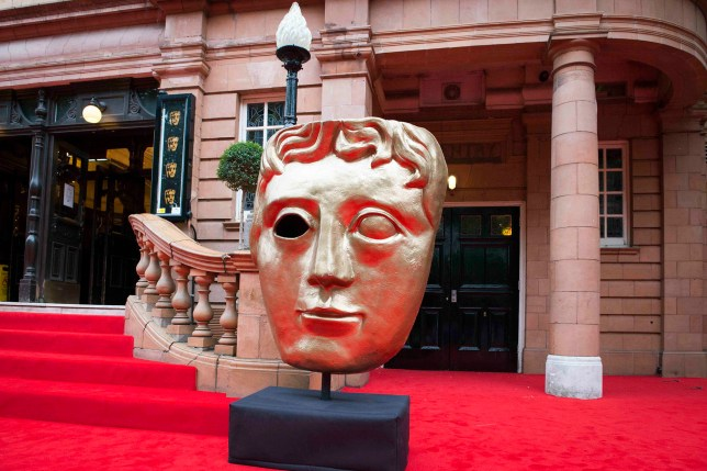 General view of a giant BAFTA head sculpture on the red carpet at the BAFTA Downton Abbey Celebration at the Richmond Theatre - London