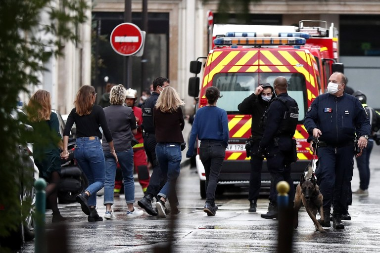 epa08696152 People are evacuated near Rue Nicolas Appert close to the former Charlie Hebdo offices, in Rue Nicolas Appert in Paris, France, 25 September 2020, after four people have been wounded in knife attack. According to recent reports, one assailant has been arrested in the Bastille area. EPA/IAN LANGSDON