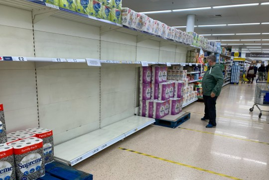 Photo provided by Bav Media 07976 880732. The photo dated September 26 shows shelves of toilet paper being emptied on Saturday morning at Tesco in Ely, Cambridgeshire, as panic shopping continues. In this store, customers are now limited to one item of certain products. Shelves are being emptied in supermarkets across England as customers panic and shop in anticipation of yet another lockdown. Shoppers are panicking buying essentials such as baked rice, pasta and beans as coronavirus figures continue to rise across the UK. Many are starting to stock up on cleaning and storage supplies, just as they did in March before the first nationwide lockdown.