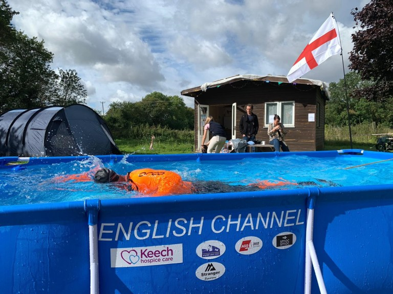 Andrew Ellman swimming in the channel in a paddling pool