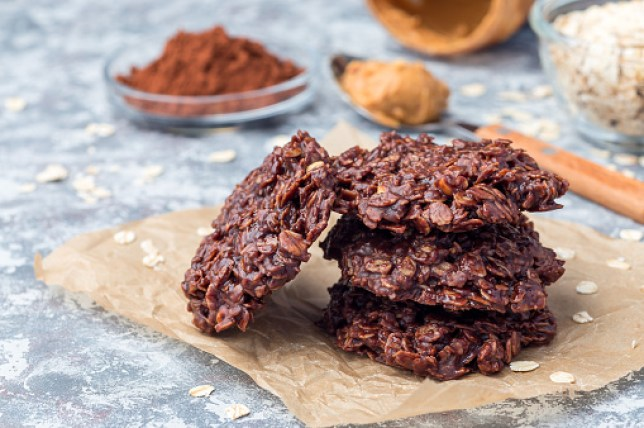 Flourless no bake peanut butter and oatmeal chocolate cookies on  parchment, horizontal