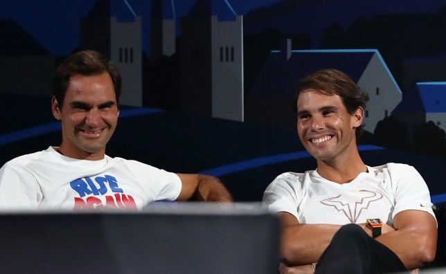 Rafael Nadal of Team Europe and teammate Roger Federer share a joke during the singles match between Stefanos Tsitsipas of Team Europe and Taylor Fritz of Team World during Day One of the Laver Cup 2019 at Palexpo on September 20, 2019 in Geneva, Switzerland. The Laver Cup will see six players from the rest of the World competing against their counterparts from Europe. Team World is captained by John McEnroe and Team Europe is captained by Bjorn Borg. The tournament runs from September 20-22.