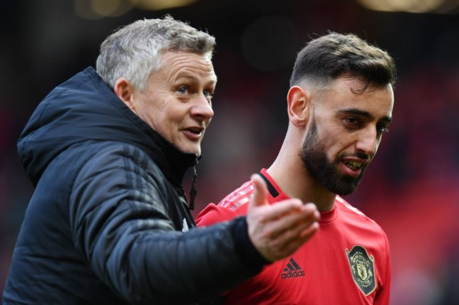 Manchester United's Portuguese midfielder Bruno Fernandes (R) and Manchester United's Norwegian manager Ole Gunnar Solskjaer (L) react as they leaves the pitch at the end of the English Premier League football match between Manchester United and Watford at Old Trafford in Manchester, north west England, on February 23, 2020.