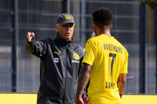 Lucien Favre and Manchester United transfer target Jadon Sancho look on in Borussia Dortmund pre-season
