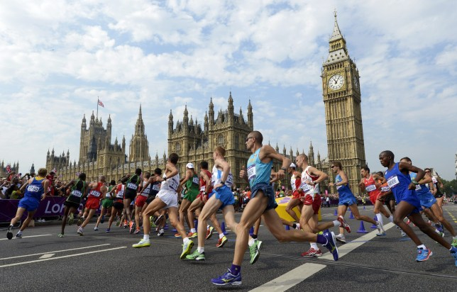Athletes run in front of Big Ben and the Palace of Westminster during the men's marathon at the London 2012 Olympic Games. (Photo by DANIEL GARCIA/AFP via Getty Images)