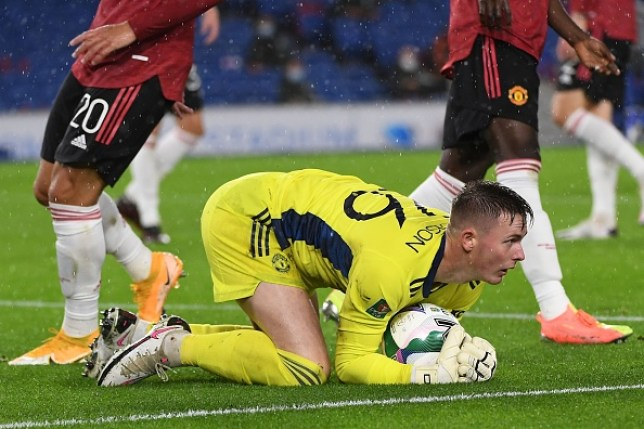 Dean Henderson collects the ball during Manchester United's Carabao Cup clash with Brighton