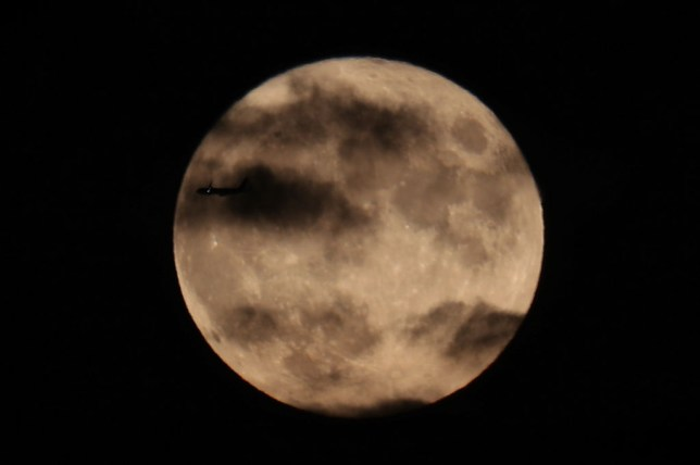 Full moon in the night sky above New York City