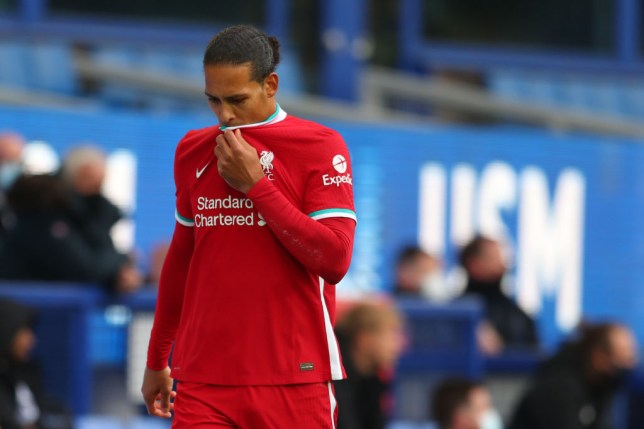 Liverpool's Dutch defender Virgil van Dijk leaves the field injured during the English Premier League football match between Everton and Liverpool at Goodison Park in Liverpool, north west England on October 17, 2020.