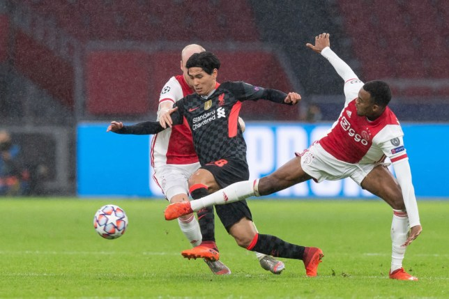 Takumi Minamino runs with the ball during Liverpool's Champions League win over Ajax