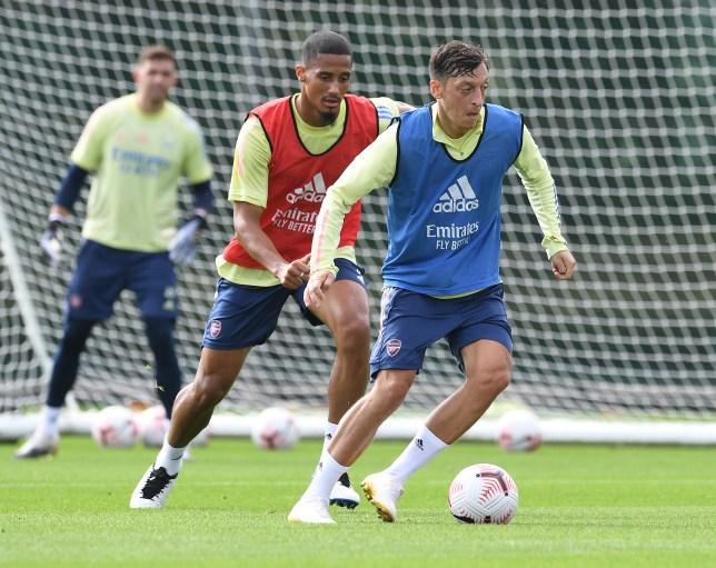 William Saliba and Mesut Ozil in Arsenal training