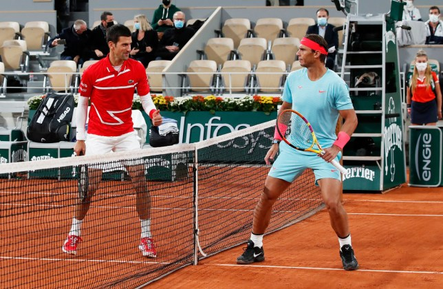 Rafael Nadal of Spain (R) and Novak Djokovic of Serbia pose for a photo on Court Philippe-Chatrier ahead of their Men's Singles Final on day fifteen of the 2020 French Open at Roland Garros on October 11, 2020 in Paris, France.