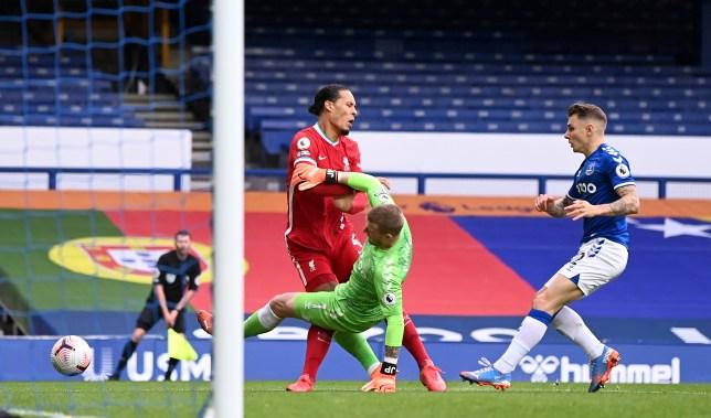 Virgil van Dijk injured after a horror challenge from Jordan Pickford in Liverpool's Premier League clash with Everton