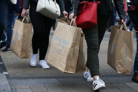 Women carrying Primark shopping bags.