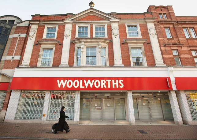 A woman walks past a closed branch of Woolworths on December 30, 2008 in Croydon, London, England.