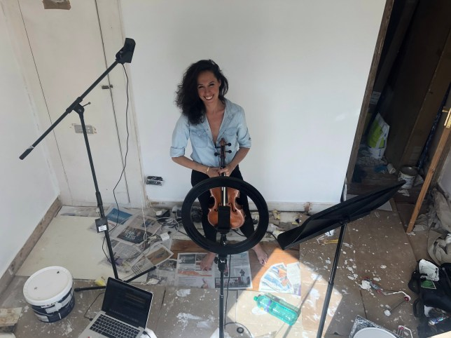 Musician Jordan Bergmans at home surrounded by recording equipment