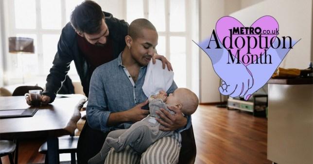 Gay dads feeding baby
