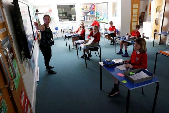 WATLINGTON OXFORDSHIRE - Children and a teacher are seen in a classroom at Watlington Primary School as some schools re-open, following the outbreak of the coronavirus disease (COVID-19), Watlington, Britain, June 1, 2020. REUTERS/Eddie Keogh