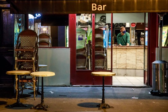 A bar employee prepares the closure of his bar the first day of the application of new health restriction measures in Paris, France, 28 September 2020.