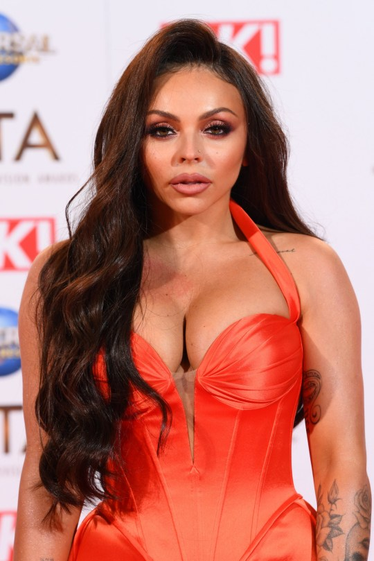 Jesy Nelson in orange dress