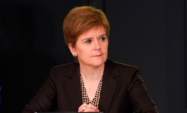 A handout picture released by the Scottish Government on October 2, 2020 shows Scotland's First Minister, Nicola Sturgeon speaking during the Scottish government's daily briefing on the novel coronavirus COVID-19 outbreak, at St. Andrew's House, Edinburgh. - Scotland's First Minister and SNP leader Nicola Sturgeon has told Margaret Ferrier to quit as an MP after breaking coronavirus rules by travelling between Glasgow and Westminster having tested positive for the novel coronavirus Covid-19. (Photo by - / Scottish Government / AFP) / RESTRICTED TO EDITORIAL USE - MANDATORY CREDIT