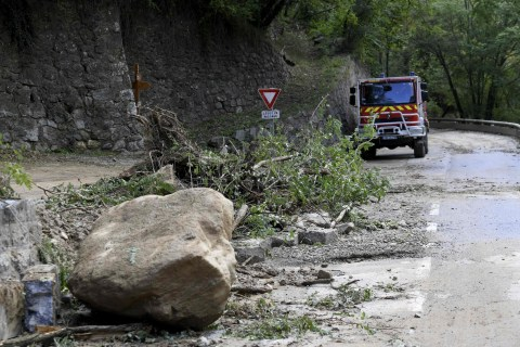 An emergency services vehicle stands on a road covered in debris ay Roquebilliere, south-eastern France, on October 3, 2020, after the town in the Alpes-Maritimes department was struck by a severe storm. - One person died and authorities listed some 20 as missing after heavy storms lashed southern France and northern Italy with hundreds of aid workers deployed to villages cut off by the deluge. (Photo by NICOLAS TUCAT / AFP) (Photo by NICOLAS TUCAT/AFP via Getty Images)