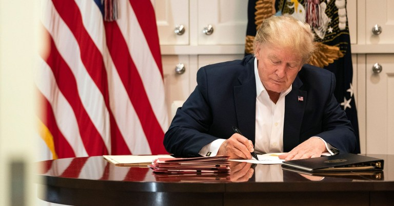 United States President Donald J. Trump 'works' in the Presidential Suite at Walter Reed National Military Medical Center in Bethesda, Maryland, after testing positive for COVID-19.