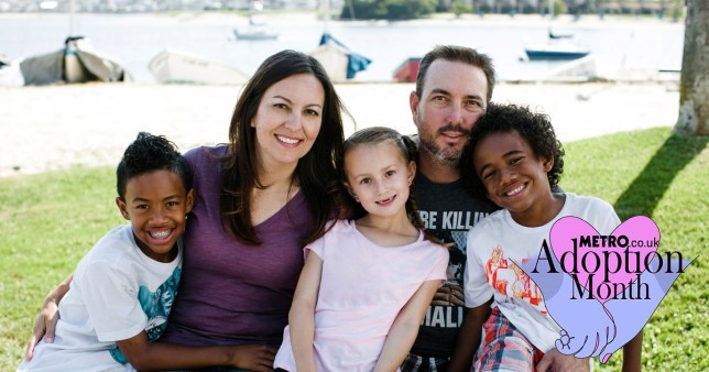 Family with three kids, two black kids and one white
