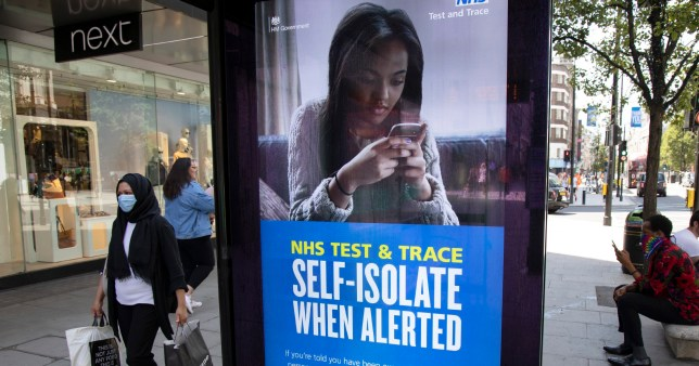 HM Government, Public Health England, NHS advertising boards advice to stay alert to the symptoms as part of the test and trace program as the Coronavirus lockdown measures are set to ease further, the west end starts to fill with people as they return to the shopping district on Oxford Street and the quiet city starts coming to an end on 22nd June 2020 in London, England, United Kingdom.