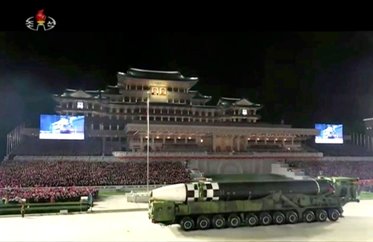 This image made from video broadcasted by North Korea's KRT, shows a military parade with what appears to be a possible new intercontinental ballistic missile