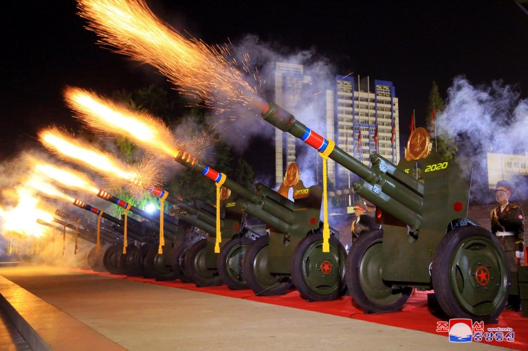 A gun salute is fired during a parade to mark the 75th anniversary of the founding of the ruling Workers' Party of Korea