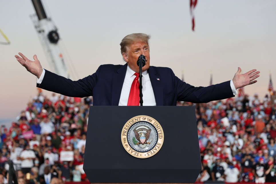 U.S. President Donald Trump speaks during a campaign rally, his first since being treated for the coronavirus disease (COVID-19), at Orlando Sanford International Airport in Sanford, Florida, U.S., October 12, 2020.