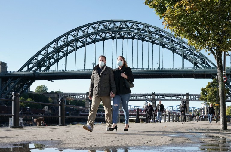 Embargoed to 1000 Wednesday October 14 File photo dated 08/10/20 of people wearing masks walking near the Tyne Bridge in Newcastle. A new study has found that England, Wales and Scotland are among nations with the highest numbers of excess deaths as a result of the first wave of the Covid-19 pandemic. PA Photo. Issue date: Wednesday October 14, 2020. The research, led by Imperial College London, analysed weekly death data from 19 European countries, Australia, and New Zealand, between mid-February and end of May. See PA story HEALTH Coronavirus ExcessDeaths. Photo credit should read: Owen Humphreys/PA Wire