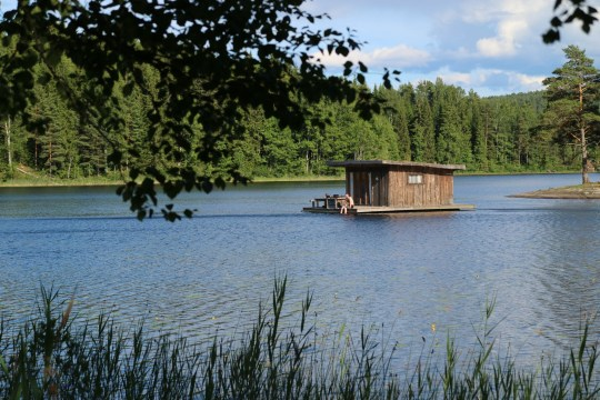 View of a cabin on a lake at Naturbyrn