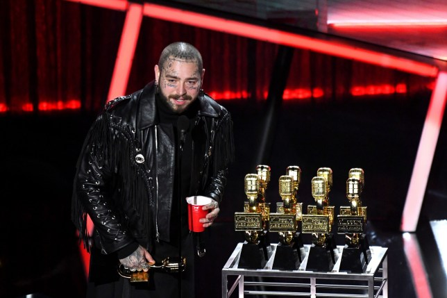 HOLLYWOOD, CALIFORNIA - OCTOBER 14: In this image released on October 14, Post Malone accepts the Top Artist Award onstage at the 2020 Billboard Music Awards, broadcast on October 14, 2020 at the Dolby Theatre in Los Angeles, CA. (Photo by Kevin Mazur/BBMA2020/Getty Images for dcp)