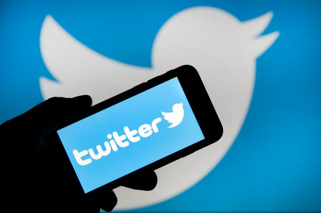 In this photo illustration the Twitter logo is displayed on the screen of an iPhone in front of a computer screen displaying a Twitter logo on February 07, 2019 in Paris, France.