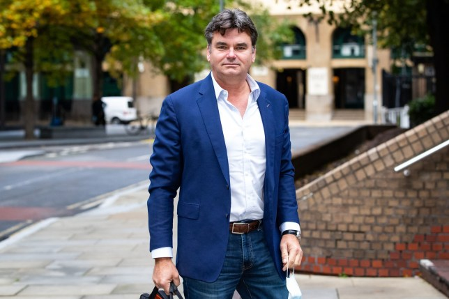 Former BHS owner Dominic Chappell arrives at Southwark Crown Court in London where he is charged with tax fraud. PA Photo. Picture date: Friday October 16, 2020. Chappell, who purchased BHS in 2015, is accused of approximately GBP 500,000 worth of cheating the public revenue on three charges, one related to VAT, a second regarding corporation tax and a third for income tax. See PA story COURTS Chappell. Photo credit should read: Aaron Chown/PA Wire