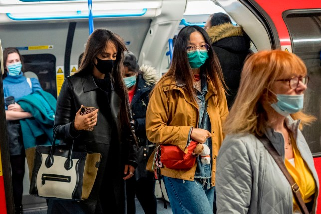 Commuters wear face-masks during morning rush hour on the Victoria Line of the London Underground in central London on October 16, 2020, as the number of novel coronavirus COVID-19 cases. - Roughly half of England is now under tougher coronavirus restrictions, after the government on Thursday announced more stringent measures for London and seven other areas to try to cut surging numbers of cases. (Photo by Tolga Akmen / AFP) (Photo by TOLGA AKMEN/AFP via Getty Images)