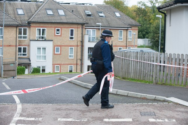 ??Licensed to London News Pictures 17/10/2020 Coulsdon, UK. Police have taped off the scene. A policeman standing guard at the flats. A murder investigation has been launched by police after a 59 year old man was beaten and stabbed in a flat in Coulsdon, London last night. A large police cordon is in place. Photo credit:Grant Falvey/LNP