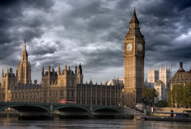 UK London Big Ben and Westminster bridge viewed over the river Thames stormy Skies