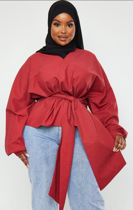 Black woman wearing hijab advertising clothes online