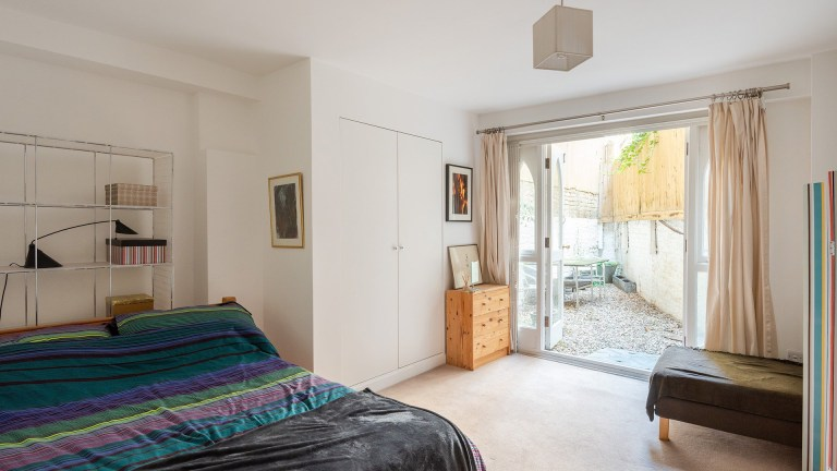 bedroom with access to rear terrace
