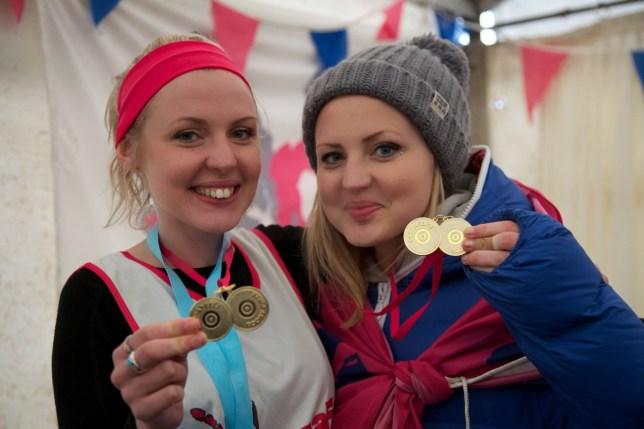 Kris & Maren Hallenga holding their medals at the Bath Half marathon