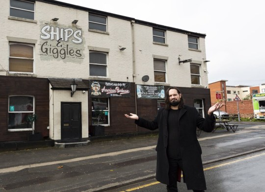 Defiant pub owner, Andy MacDonald, 36, has started selling meals for a penny to save his business, The Ships & Giggles in Preston, as Lancashire has now moved into Tier 3 Covid restrictions, pictured in Lancs, Oct 22 2020.See SWNS story SWLEpenny. A defiant pub owner desperate to save his business is offering regulars meals for a penny to get around newly-introduced, strict Tier 3 Covid restrictions. Andy MacDonald, 36, is the landlord of the Ships and Giggles pub in Preston, Lancs, which was placed under the strictest Covid rules last Friday (Oct 16). Preston Council environmental health officials said the rules meant that pubs could only stay open if they served 'substantial food' with drinks. Mr MacDonald offered punters free fish nuggets and chips from last Saturday (Oct 17) but was then told by council chiefs he was flouting the rules because he was giving the food away.