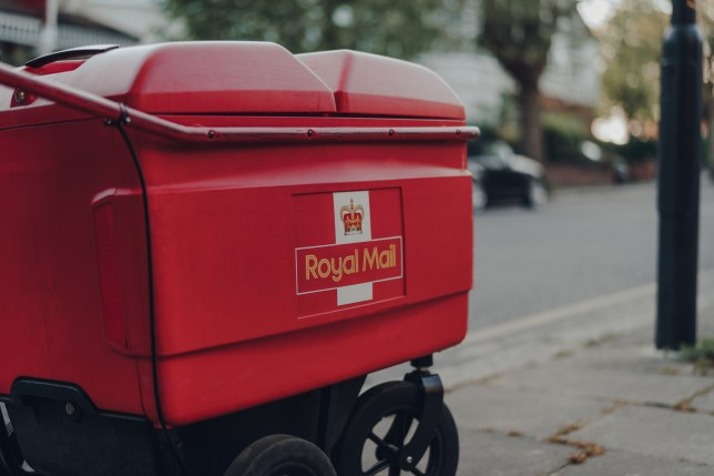London, UK - April 22, 2020: Red delivery troll belonging to Royal Mail on a street in London. Royal Mail is a postal service and courier company in the United Kingdom, originally established in 1516.