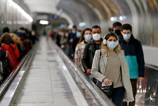 PARIS, FRANCE - OCTOBER 27: Passengers wearing face masks use a moving walkway in metro corridors shortly before the 9pm city-wide night time curfew during the coronavirus (COVID-19) pandemic on October 27, 2020 in Paris, France. From October 28, the Paris region???s public transport network will be cut down to one metro in two after 9 p.m, ten days after the establishment of a curfew in the region as the coronavirus continues to circulate in France. Even though 54 French departments imposed a 9 p.m to 6 a.m curfew on Saturday, a record number of daily cases for the country has been reported in the last few days. The French government has said that they cannot rule out another lockdown if the situation does not improve. President Emmanuel Macron will deliver a televised speech to the nation on Wednesday to announce new measures in the fight against COVID-19. (Photo by Chesnot/Getty Images)