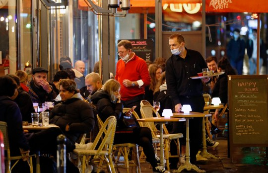 PARIS, FRANCE - OCTOBER 27: People enjoy a drink on a restaurant terrace shortly before the 9pm city-wide night time curfew during the coronavirus (COVID-19) pandemic on October 27, 2020 in Paris, France. Ten days after the establishment of a curfew in the region as the coronavirus continues to circulate in France. Even though 54 French departments imposed a 9 p.m to 6 a.m curfew on Saturday, a record number of daily cases for the country has been reported in the last few days. The French government has said that they cannot rule out another lockdown if the situation does not improve. French President Emmanuel Macron will deliver a televised speech to the nation on Wednesday to announce new measures in the fight against COVID-19. measures to fight against the coronavirus epidemic. (Photo by Chesnot/Getty Images)