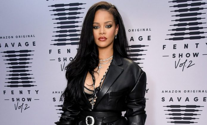 Image result for Rihanna poses topless in Savage X Fenty boxers and jewels