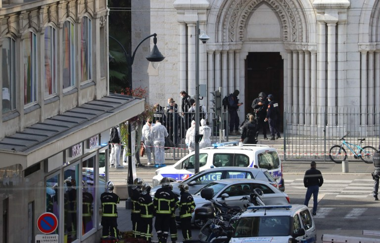 French members of the elite tactical police unit RAID enter to search the Basilica of Notre-Dame de Nice as forensics officers wait outside after a knife attack in Nice on October 29, 2020. - A man wielding a knife outside a church in the southern French city of Nice slit the throat of one person, leaving another dead and injured several others in an attack on Thursday morning, officials said. The suspected assailant was detained shortly afterwards, a police source said, while interior minister Gerald Darmanin said on Twitter that he had called a crisis meeting after the attack. (Photo by Valery HACHE / AFP) (Photo by VALERY HACHE/AFP via Getty Images)